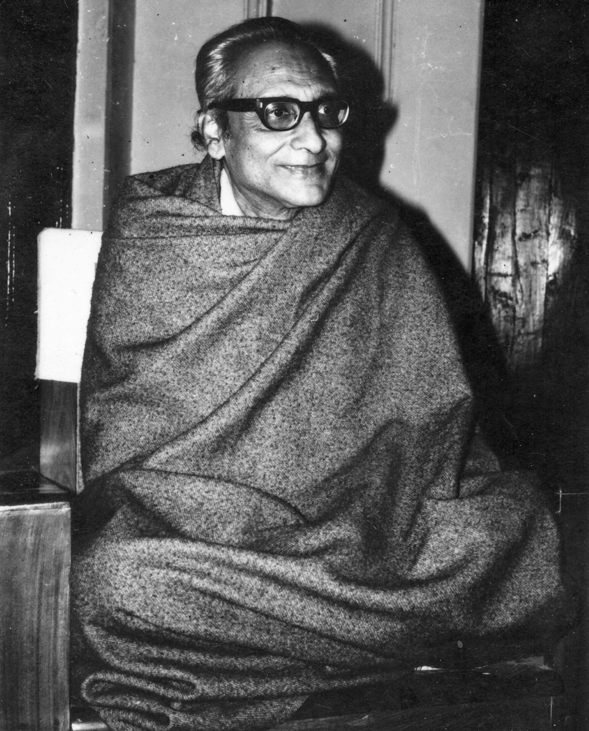Banmali sits cross-legged on a wooden-framed easy-chair, tucks his grey shawl under his legs and looks calm and peaceful with a gentle smile and bright, inquisitive eyes behind his thick glasses.